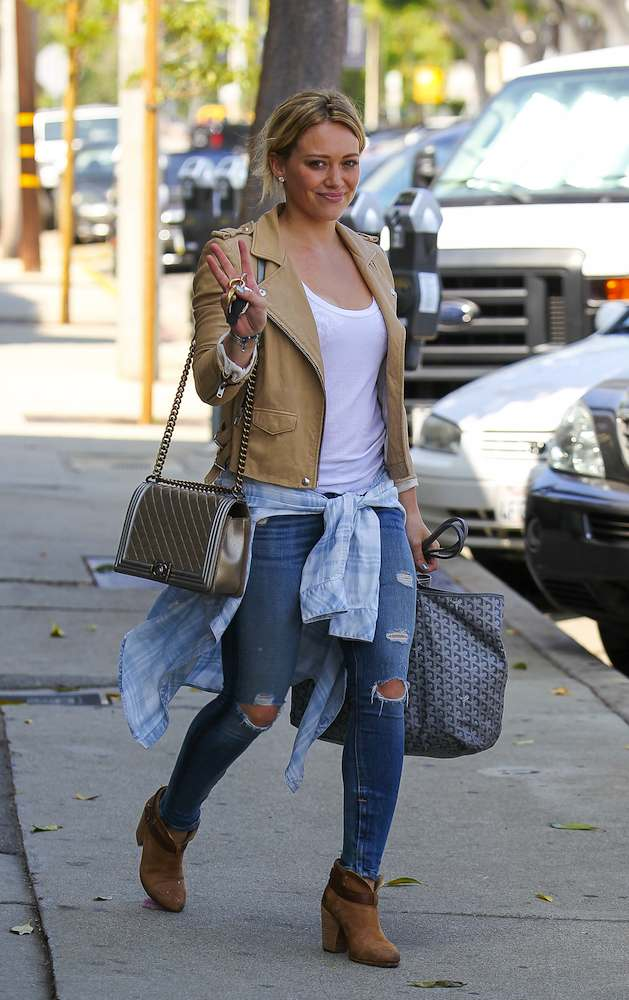 Hilary Duff spotted leaving a gym on Melrose Blvd. after a workout, wearing a motorcycle jacket and ripped jeans Featuring: Hilary Duff Where: Los Angeles, California, United States When: 22 Aug 2014 Credit: WENN.com